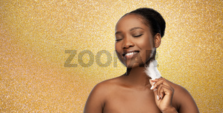 happy african american woman with feather
