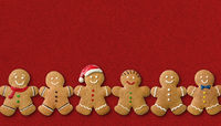 Many Gingerbread men on a red background