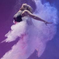 Girl in pointe shoe in dust cloud profile shot