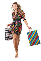 Young happy blonde woman in black dress with colorful shopping bags on a white background