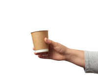 female hand holds paper brown disposable cup for coffee and tea