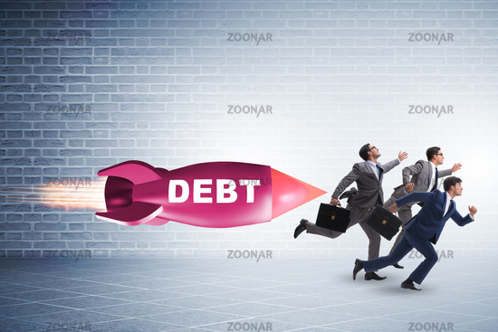 Concept of loan and debt with businessman chased by rocket