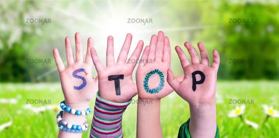 Children Hands Building Word Stop, Grass Meadow