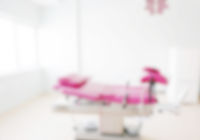Defocused blur background of gynecological examination chair