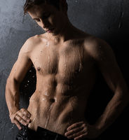 Handsome shirtless blond view against gray wall
