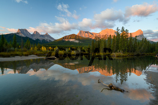 The Three Sisters Alberta in sunrise sky