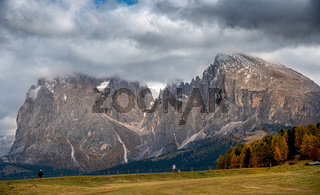 Mountain landscape with  and unrecognised people hiking  at the at the famous Alpe di Siusi valley South Tyrol in Italy