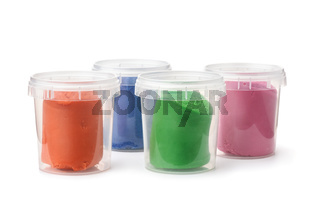 Plastic containers with colorful modeling clay