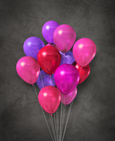 Pink air balloons group on a concrete background
