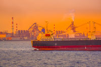 Cargo ship silhouette and sunset