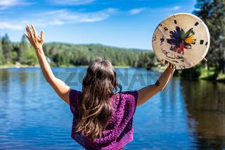 A woman's ritual lakeside dance