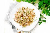 Salad of salmon and rice in plate on board top