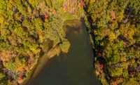 Top down aerial view of Coopers Rock Lake in the state park with autumn and fall colors