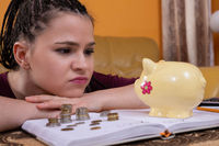 The teenager wonders how to spend the last money she has left after making all the necessary monthly payments for the apartment and all utilities.