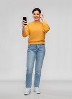 woman in headphones with smartphone