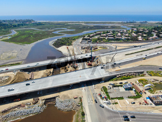 Aerial view of highway bridge construction over small river