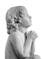 Boy statue pray to God with hands held together. Beautiful old stone statue of praying child isolated on white background