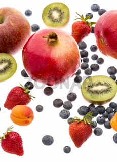 Variety Of Fruit Spread Out On White Background
