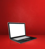 Laptop computer on red office scene background