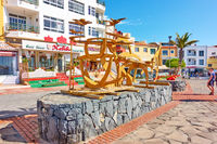 Waterfront with modern wooden sculpture in Los Abrigos