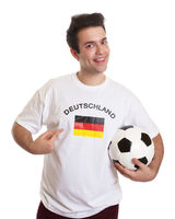 Proud german soccer fan with football