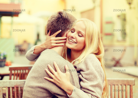 romantic happy couple hugging in the cafe