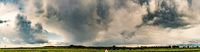 Stormy and dramatic sky panorama of rural area.