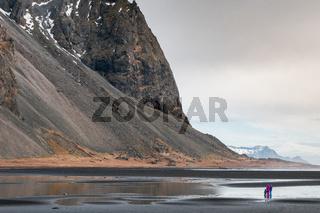 People enjoying the scenery of the Vestrahorn mountain near Hofn village in Iceland Europe
