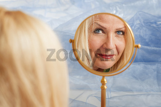 beautiful middle aged woman in the Vanity mirror
