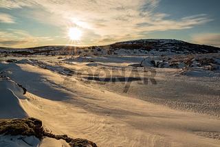 Iced lake in Gardabaer at sunrise, Iceland