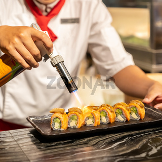 Chef cooking Salmon Foie gras roll,