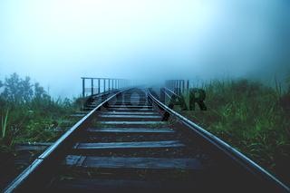 Railway bridge through foggy jungle forest, Ella Sri Lanka