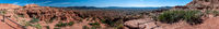 Panoramic view of red cliffs of sandstone in Sierra de las Quijadas National Park in Argentina on a bright sunny day