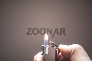 Lighter burns with a small flame to illuminate the surroundings