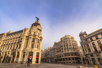 Madrid Spain, city skyline at famous Gran Via shopping street