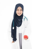 Muslim doctor hold red heart