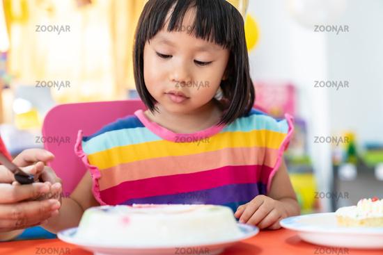Girl cut birthday cake and Celebration