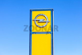 Opel dealership sign against the blue sky