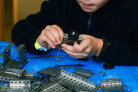 The child collects the constructor. Engineering constructions in miniature. Children's set designer for boys. The development of motor skills of hands, thinking, memory and imagination in a child.