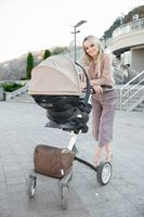 Cute mother with a pram