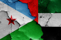 flags of Djibouti and United Arab Emirates painted on cracked wall