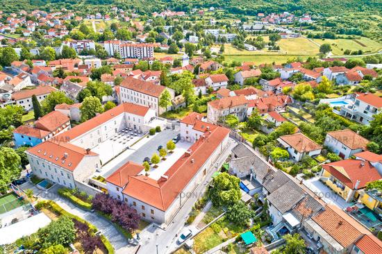 Town of Sinj in Dalmatia hinterland city center aerial view