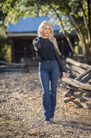 A Lovely Blonde Model Poses In Her Beautiful Fall Clothing
