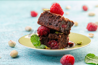 Traditional brownies with raspberries.