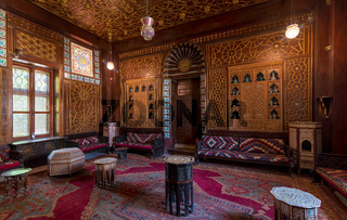 Manial Palace of Prince Mohammed Ali. Guests Hall with wooden ornate ceiling and wooden ornate door, Cairo, Egypt