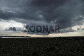 People walking on coral scrap in Gili Air, Lombok, Indonesia