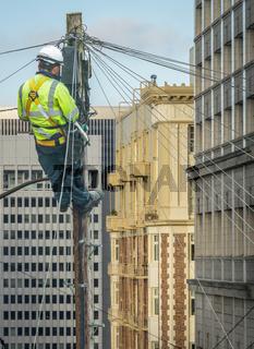Engineer Repairing An Urban Telephone Line