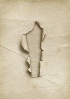 Old white torn paper with hole