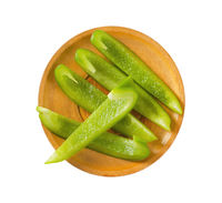 Green bell pepper slices on plate