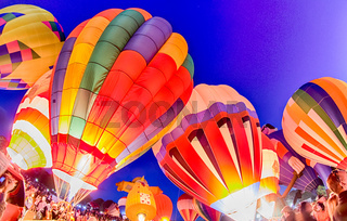 Bright Hot Air Balloons Glowing at Night